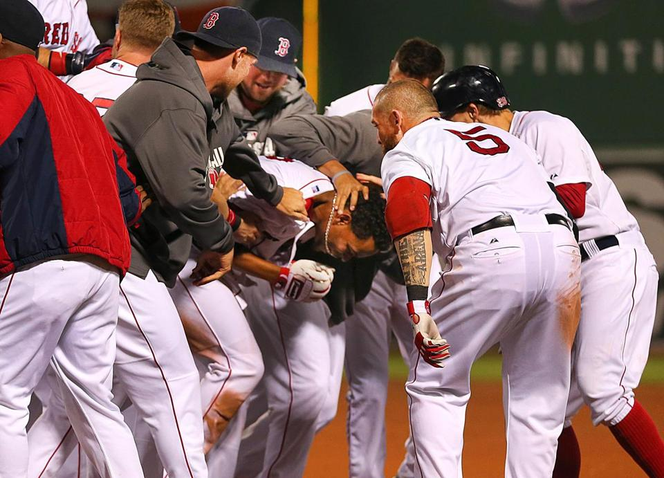 Teammates swarmed Xander Bogaerts after his infield hit led to the Red Sox winning Thursday's game.