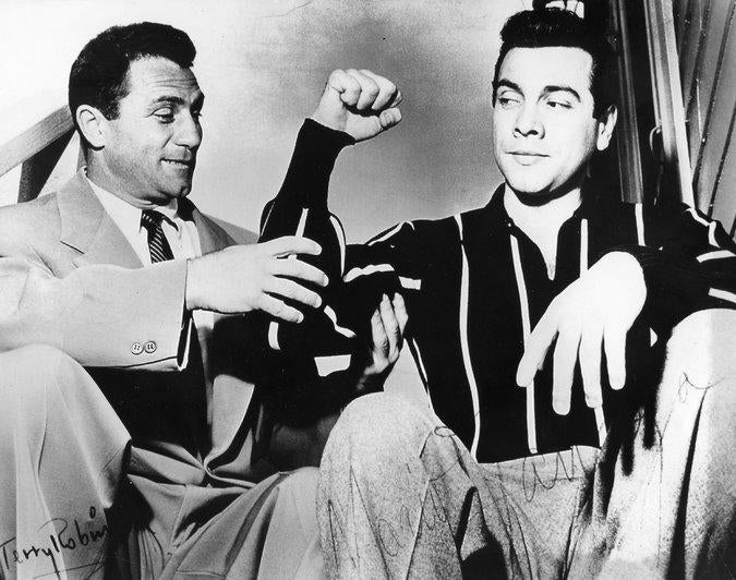 Terry Robinson (left) admired the hard work's results with tenor and actor Mario Lanza.