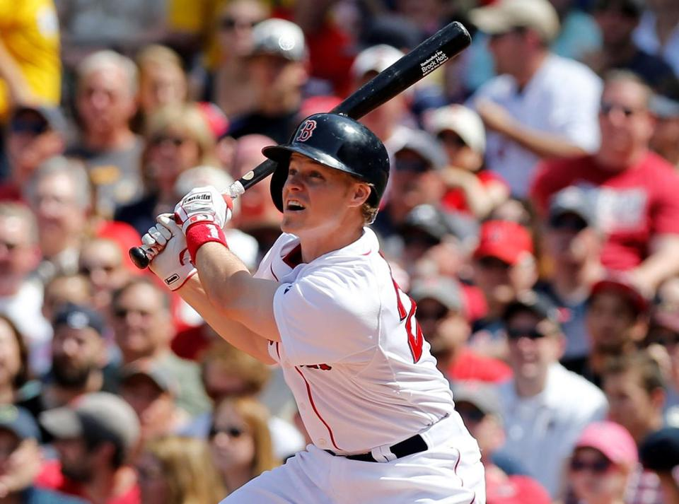 Jun 1, 2014; Boston, MA, USA; Boston Red Sox third baseman Brock Holt (26) hits an RBI double during the fourth inning against the Tampa Bays Rays at Fenway Park. Mandatory Credit: Greg M. Cooper-USA TODAY Sports