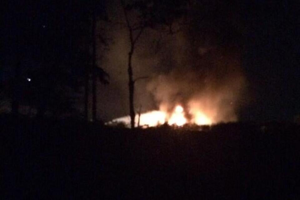 A private plane ran off a runway at Hanscom Field, causing it to erupt in flames.