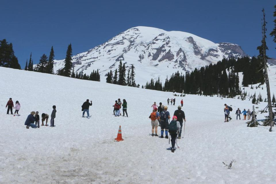 Visitors hiked through the snow near Mount Rainier's Paradise Visitor Center southeast of Seattle on Sunday.