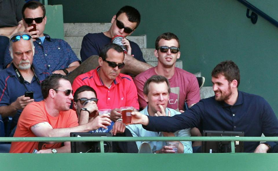 Minnesota Timberwolves forward Kevin Love (front row, far right), with agent Jeff Schwartz to his right, takes in Sunday's Red Sox game from the EMC Club at Fenway Park. Seated immediately to Love's right is his agent, Jeff Schwartz, who also represents former Celtics star Paul Pierce.