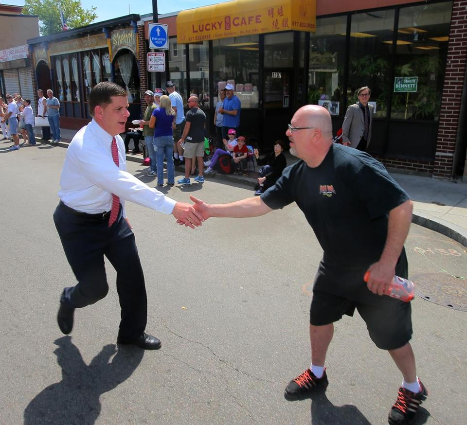 Mayor Martin J. Walsh greeted Mark Fitzpatrick on the Dorchester Day Parade route.
