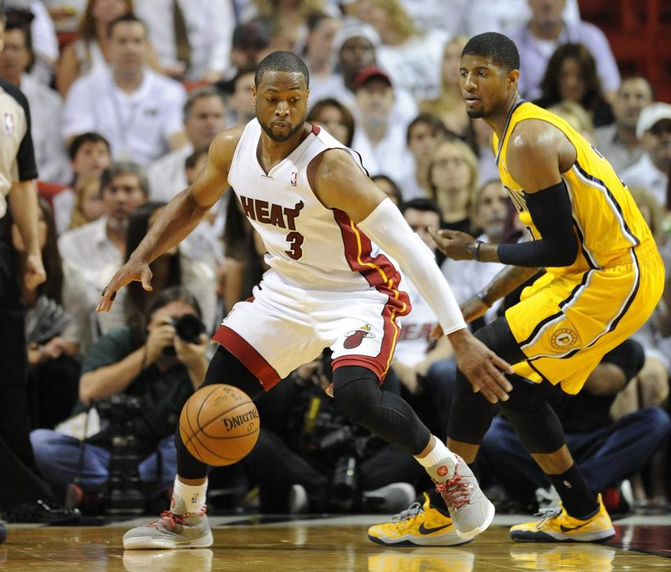 Dwayne Wade (left) said Miami's stars haven't discussed the possiblity of leaving as free agents. EPA/RHONA WISE CORBIS OUT
