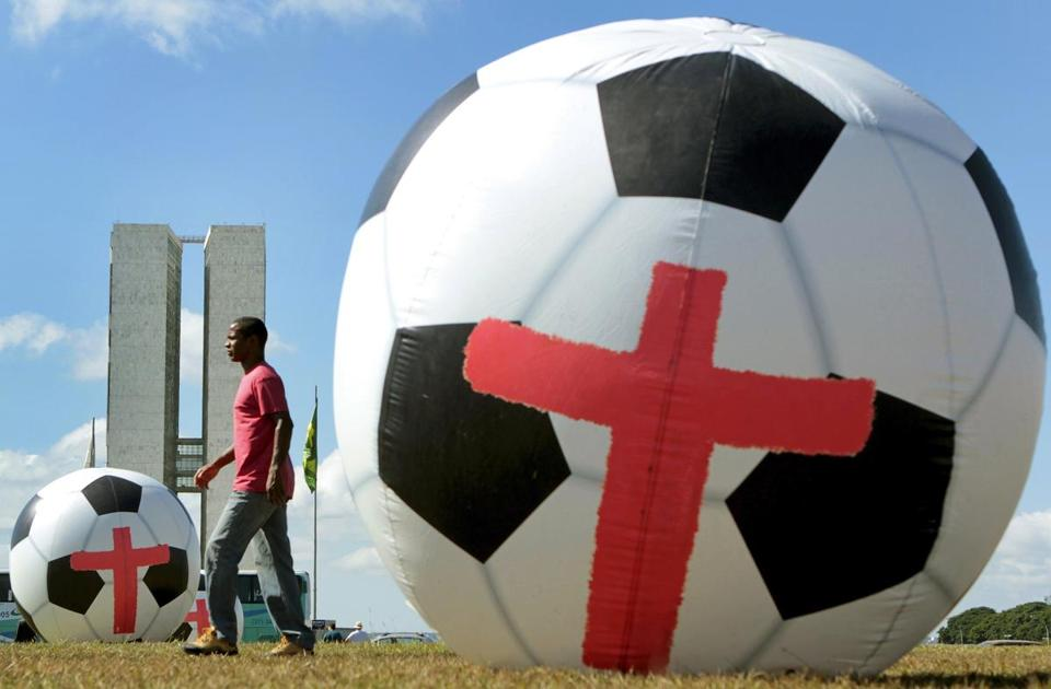 Giant inflatable soccer balls marked with red crosses were placed in front of the National Congress in Brasilia as a call for the government to provide public services of the same standards as the World Cup stadiums.