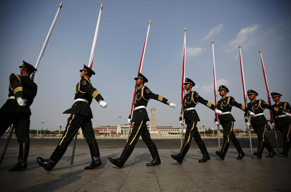 Chinese honor guards marched Tuesday past the Monument to the People's Heroes in Tiananmen Square.