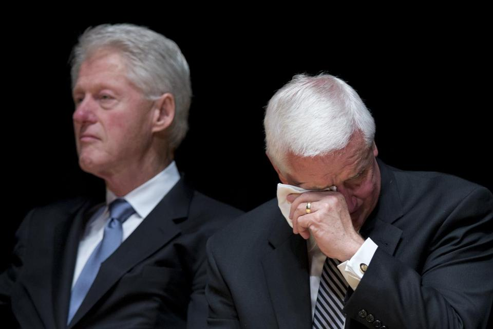 Pennsylvania Governor Tom Corbett wiped his eyes while former President Clinton listened during services.