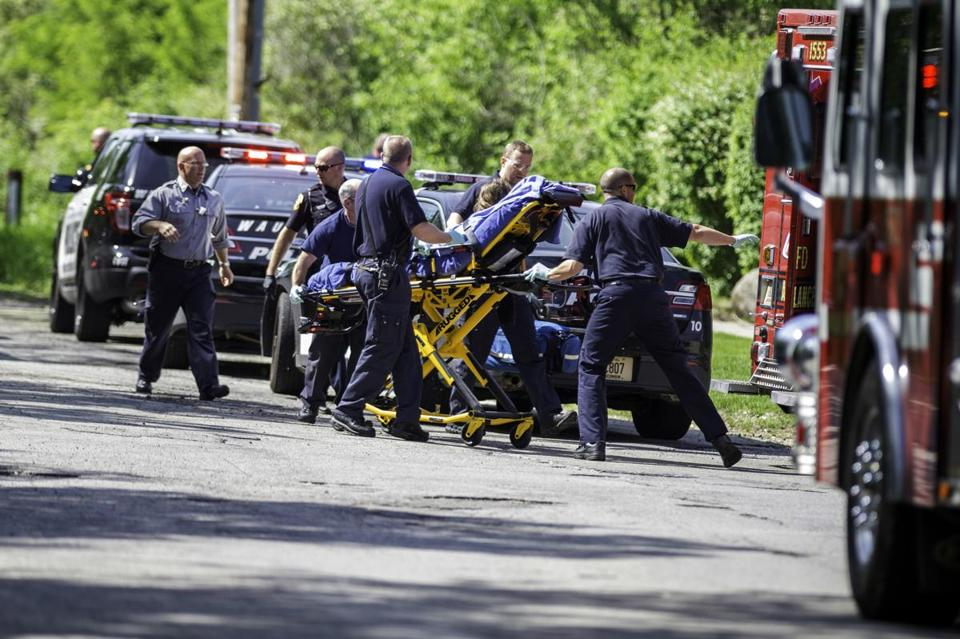 Rescue workers brought a stabbing victim to an ambulance in Waukesha, Wis., on May 31.