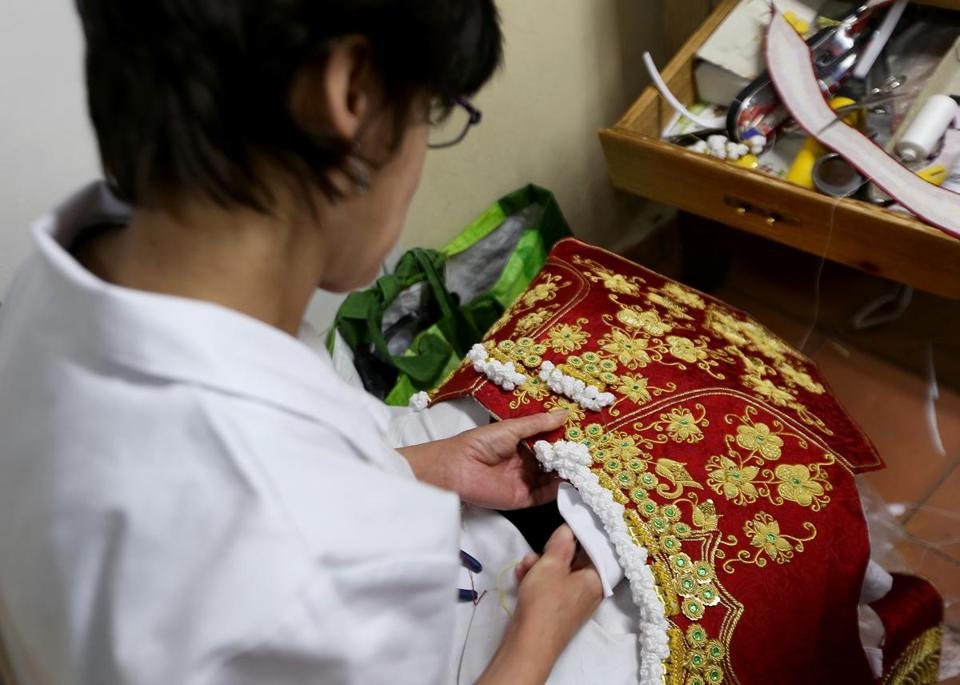 "Conche Muñez, who has been employed at Fermín for 21 years, works on the small details of famed matador José María Manzanares's new ""chaquetilla,"" or coat."