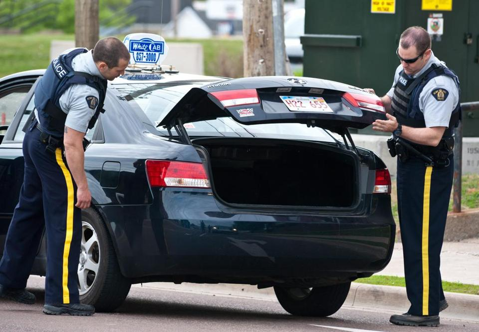 Heavily armed Royal Canadian Mounted Police officers combed streets and woods in search of 24-year-old Justin Bourque.