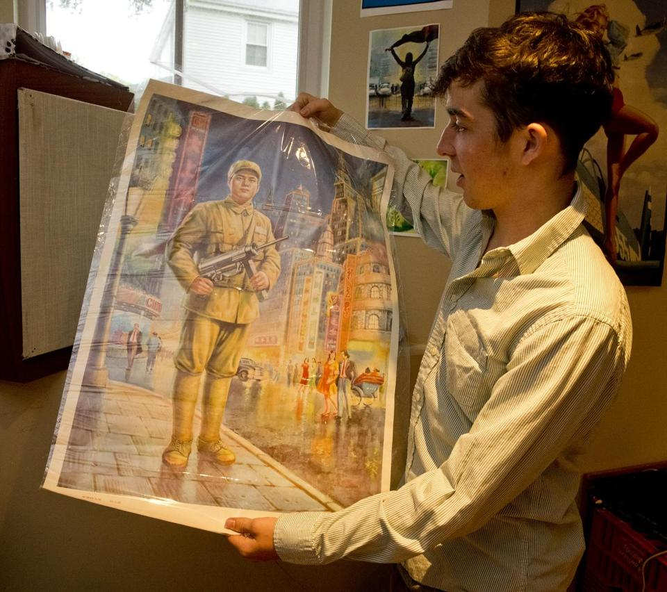 Henry DeGroot of Newton displayed a poster he brought back from China during an exchange program in which he stirred controversy for pro-democracy messages he wrote in a Chinese student's notebook.