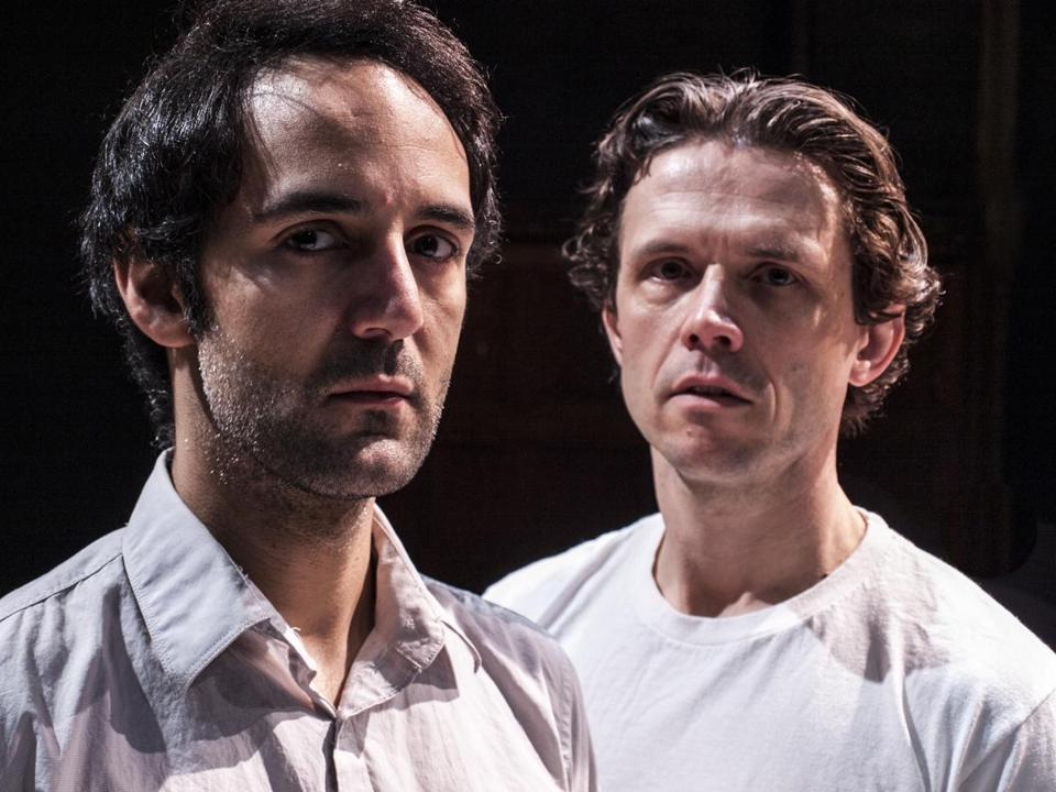 "Nael Nacer (left) and Lewis D. Wheeler play a Pakistani and a US Air Force drone operator, worlds apart, in New Repertory Theatre's production ""Pattern of Life."""
