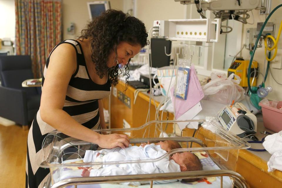 Lindalva DaSilva with her twins, Ronaldo and Alexandre Antunes, in the neonatal intensive care unit at Tufts Medical Center in Boston.
