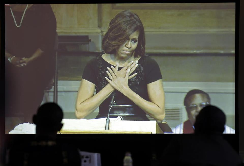 Michelle Obama, seen on a television screen, spoke during the memorial service for poet and author Maya Angelou.