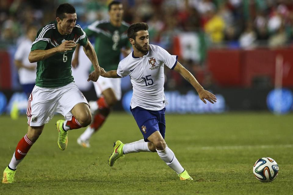 Portugal's Rafa (right) and Mexico's Hector Herrera gave chase during a friendly soccer match at Gillette Stadium. EPA/JOSE SENA GOULAO