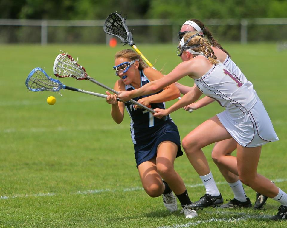 Franklin High's Maegan Schmauder (left) battles Concord-Carlisle players for the ball . . .