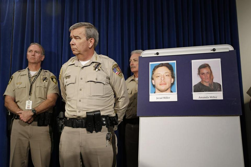 Las Vegas Sheriff Doug Gillespie (right) displayed photos of the shooting suspects at a news conference Monday.