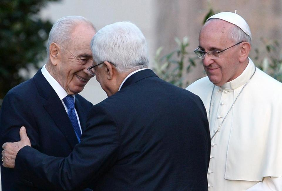Presidents Shimon Peres of Israel (left) and Mahmoud Abbas of the Palestinian territories embraced at the Vatican Sunday during an unprecedented prayer service convened by Pope Francis. Although the summit appeared unlikely to have an immediate impact on Mideast politics, it represented a revitalization of Vatican diplomatic capacity.