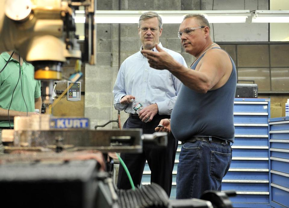 Charlie Baker spoke Monday with Carlstrom Pressed Metal plant manager Rick LaFrance.