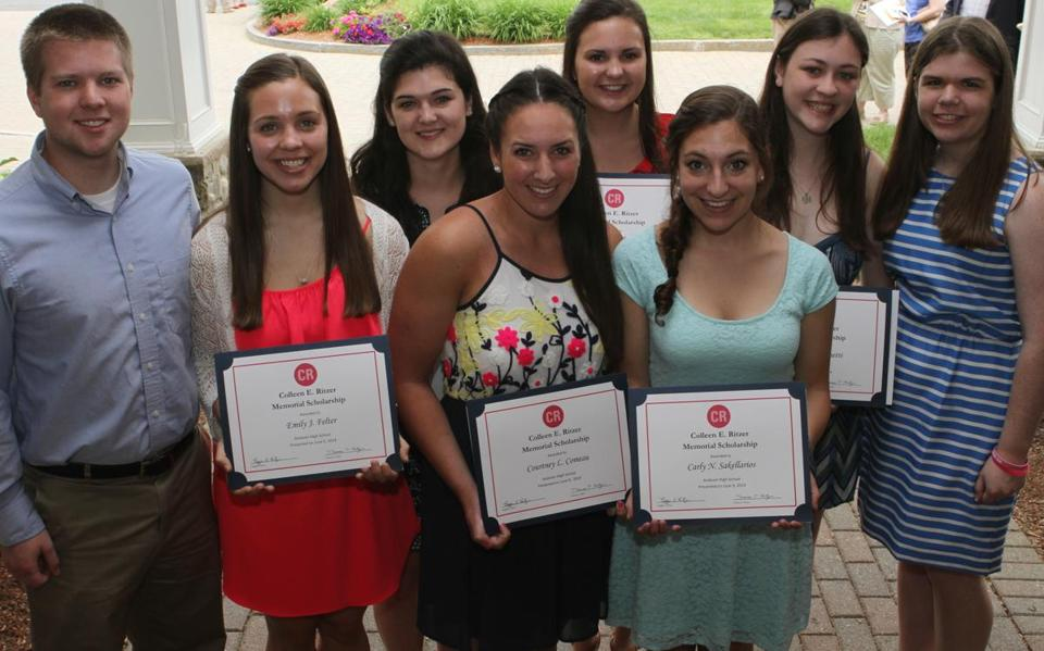 Dan (left) and Laura Ritzer (right), Colleen Ritzer's brother and sister, with Andover scholarship recipients (from left): Emily Felter, Elizabeth Dever, Courtney Comeau, Christine Aumais, Carly Sakellarios, and Jessica Ferronetti.