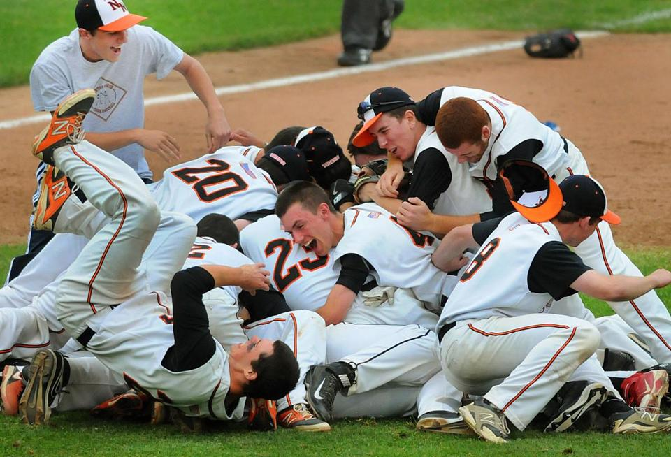 It's one big pile of joy for the Newton North players after they captured the Super 8 title. Debee Tlumacki for the Boston Globe(sports)