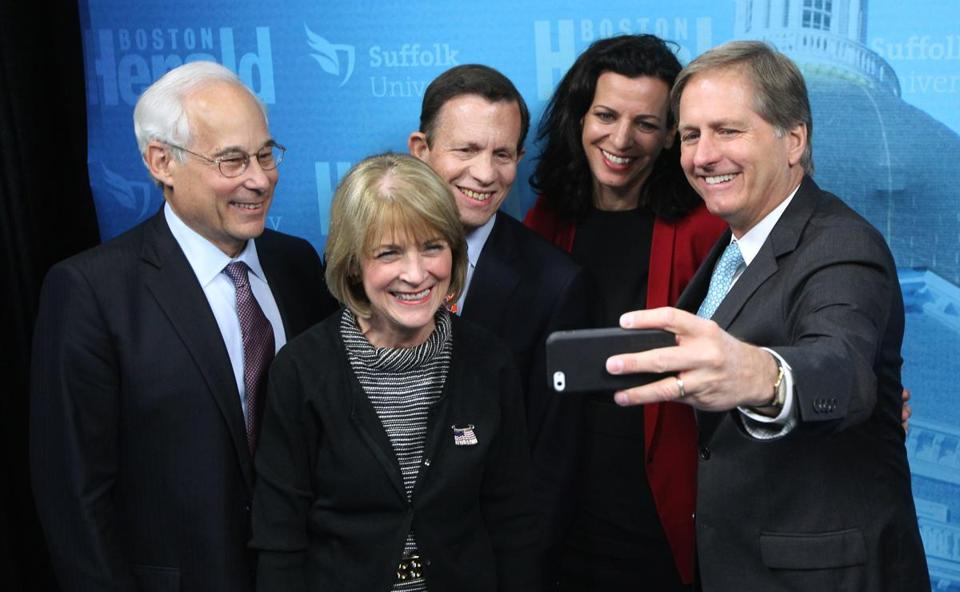 "Joseph Avellone (right) took a ""selfie"" photo of candidates after a debate at Suffolk University in Boston."
