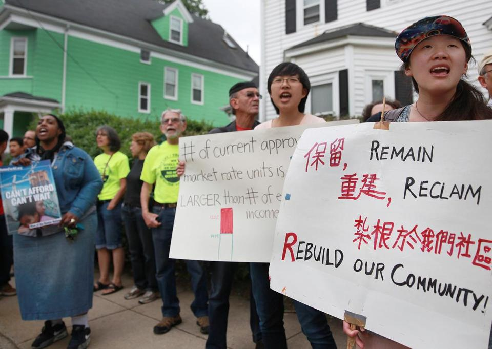Residents, tenants and housing activists staged a rally outside a foreclosed home on Norwell Street in Dorchester on Tuesday. The home is is now owned by Fannie Mae.