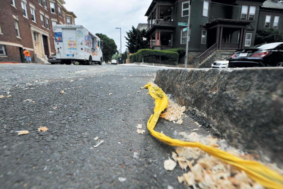 A scrap of police tape marked the spot where a man was shot to death on Harold Street in Roxbury on Sunday.
