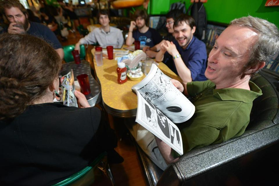 Jerry Dreiss of Brighton looks through a reproduction of a vintage comic during a comic book reading group meeting at the Friendly Toast in Cambridge. Josh Reynolds for The Boston Globe (Arts, Steinberg, lamy)