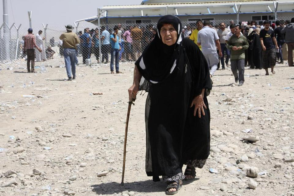 A woman was among the thousands who fled the northern Iraq city of Mosul as insurgents pushed toward Baghdad.