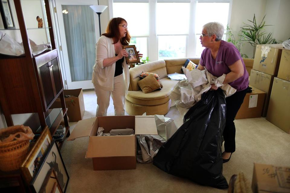 Florence Gans's daughter-in-law Lori and Joan Roover (right) unpack together.