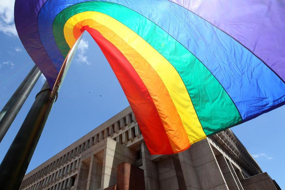 A gay pride flag was hoisted at Boston City Hall on Friday to open the city's celebration of Pride Week through events including the Pride Parade on Saturday.