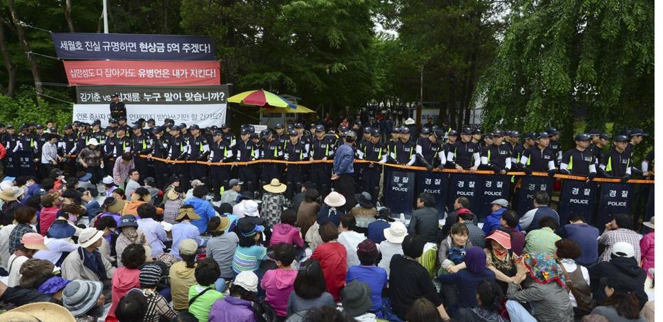 South Korean police stood guard in front of the main gate of the church property, as church members looked on Wednesday.