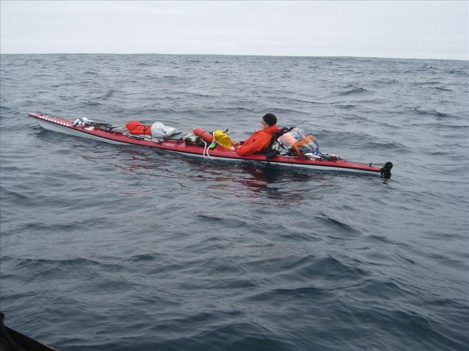 The kayaker was rescued after he turned back on his attempted voyage from California to Hawaii.