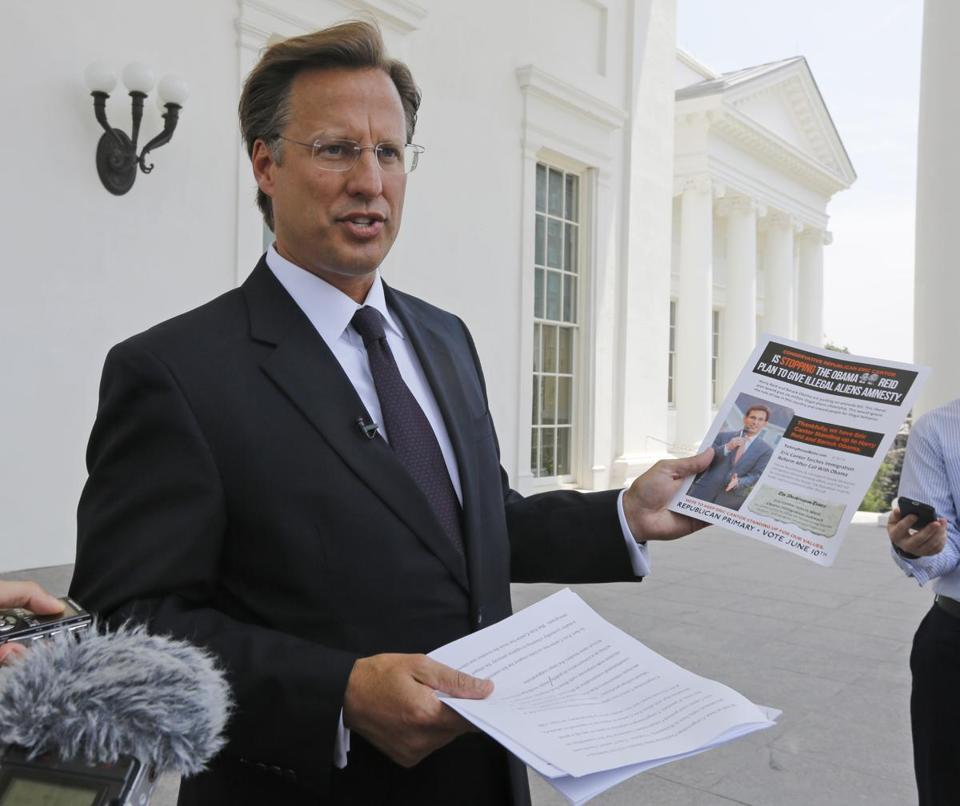 David Brat displayed an immigration mailer by Eric Cantor at the Capitol in Richmond, Va., May 28.