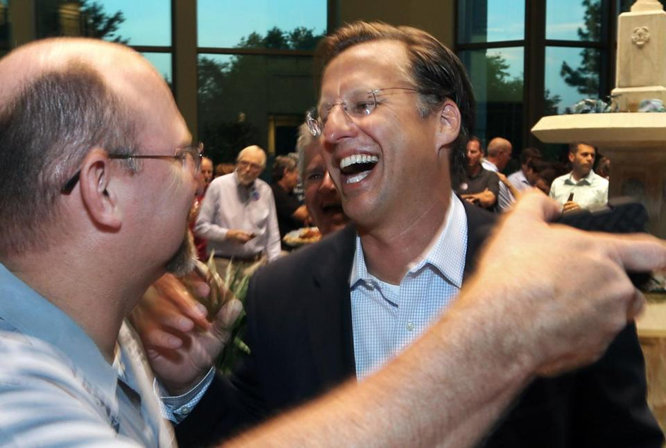 David Brat (right) was congratulated by Johnny Wetlaufer after Brat defeated House Majority Leader Eric Cantor in the Republican primary.