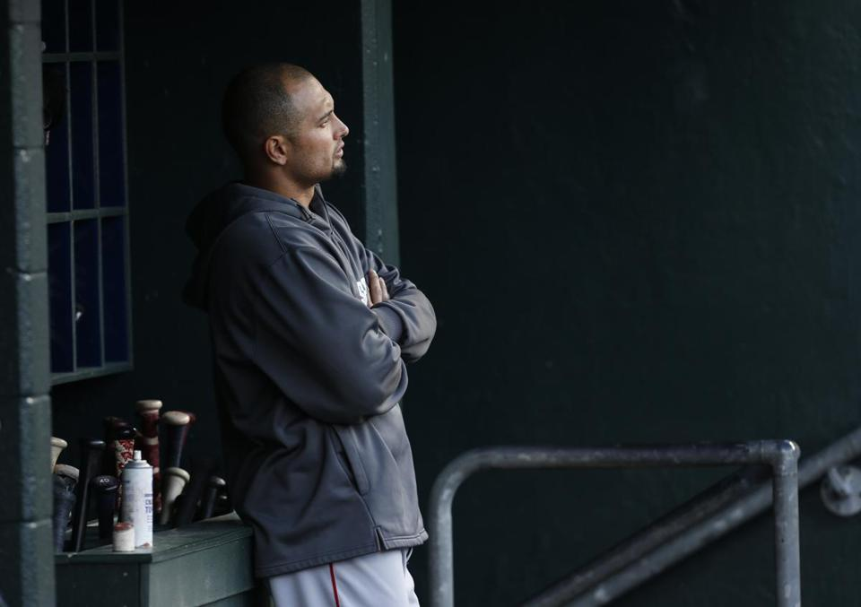It has been a lonely recovery for Red Sox outfielder Shane Victorino, who will have his back examined in Boston Thursday. (AP Photo/Paul Sancya)