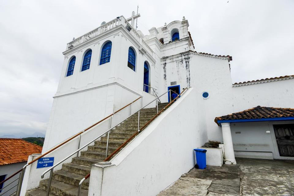 Carlos Wanzeler, out of the reach of US law in Brazil, could view a 16th-century convent on a hill overlooking Vitoria.