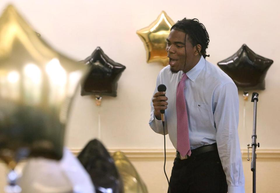 "Leonal Peguero during Boston International High School's ""passing of the torch"" ceremony."