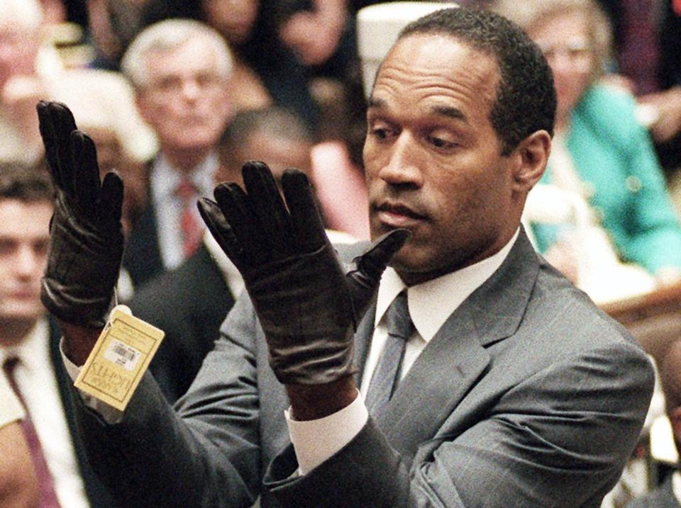 O.J. Simpson held up his hands before the jury after putting on a new pair of gloves similar to the infamous bloody gloves during his double-murder trial in Los Angeles.