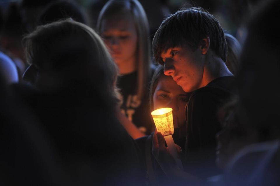 A candlelight vigil was held Tuesday night for Emilio Hoffman, the student killed at Reynolds High School.