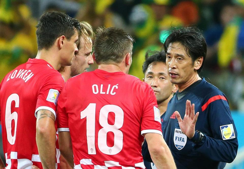 Referee Yuishi Nishimura of Japan awarded Brazil a penalty kick in the 71st minute.