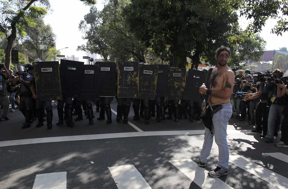 A demostrator stood in front of military police near Caarao metro station during a protest against the World Cup in Sao Paulo.
