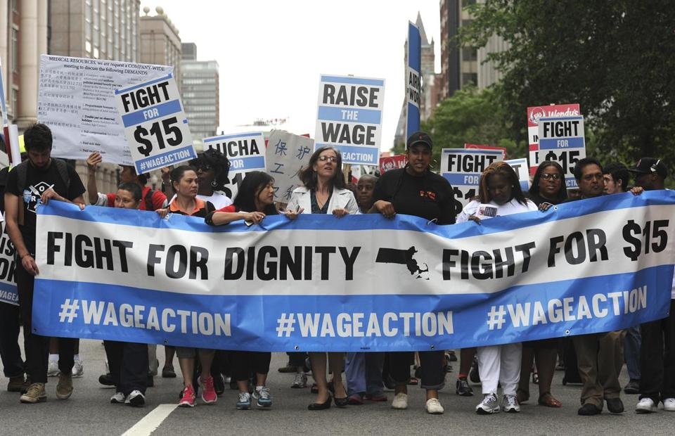 Low-wage workers from multiple industries marched in downtown Boston to draw attention to the fight for higher pay.