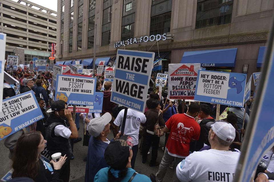 Hundreds of low-wage workers demonstrate in Boston for higher wages. (Essdras M. Suarez Photo/ Globe Staff)