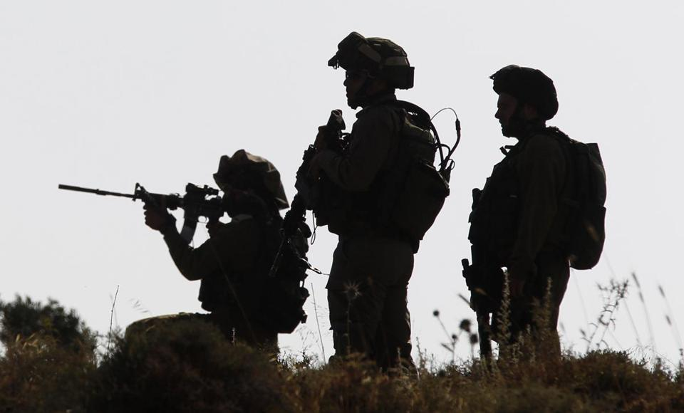 Israeli soldiers were out in force Friday looking for three teenagers who may have may have been abducted.