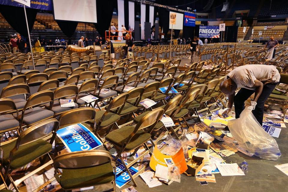 Workers began cleaning up after the state Democratic convention ended at the DCU Center in Worcester on Saturday.