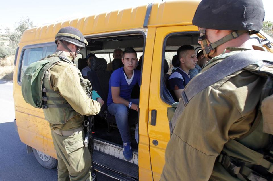 Israeli soldiers searched Saturday for three teens who disappeared near a settlement in the West Bank town of Hebron.
