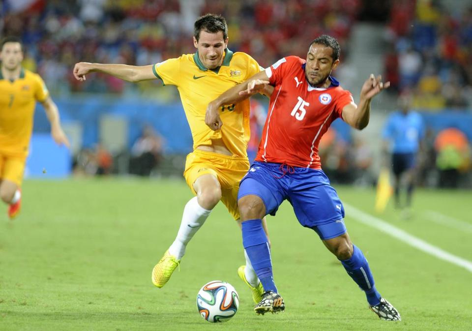 Jean Beausejour (right) and Chile were a step ahead of Ryan McGowan and Australia. EPA/GERRY PENNY