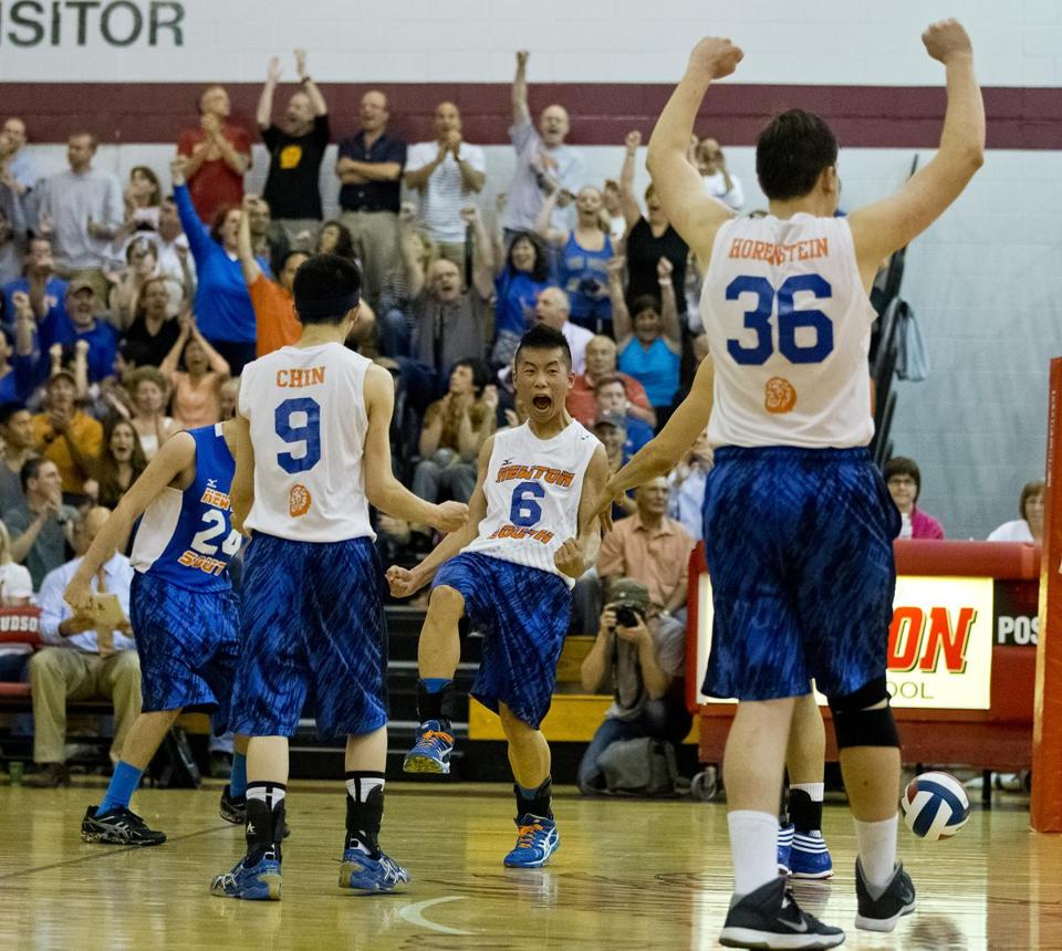 Newton South's Jonathan Lee, center, celebrates a point during the state final against Agawam.
